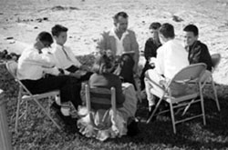 The early days on the beach having Sunday School.